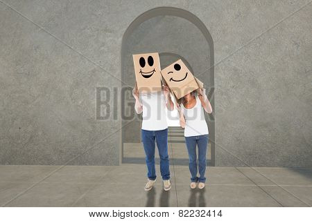 Mature couple wearing boxes over their heads against digitally generated room with doorways