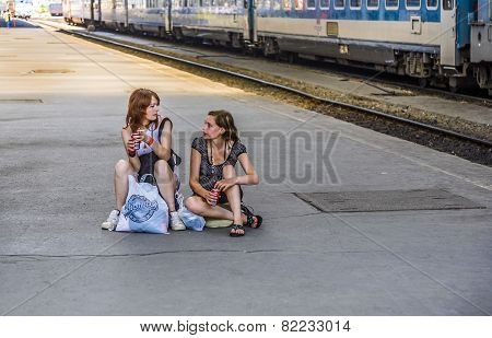 Young Teenage Girls Wait For The Train