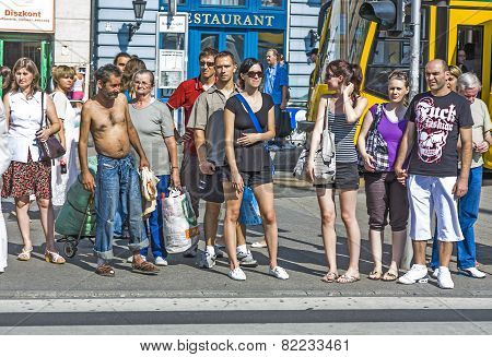 People Wait At Pedenstrian Crossing In Budapest