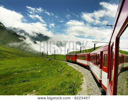 Swiss Train Crossing Oberalppass, Switzerland Alps