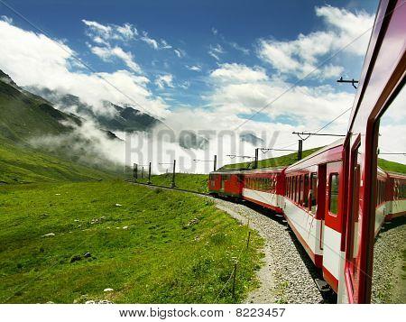 Swiss Train Crossing Oberalppass, Switzerland Alps