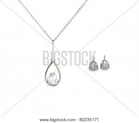Beautiful Silver Necklace And Diamond Earrings Isolated On White Background