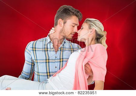 Composite image of handsome man picking up and hugging his girlfriend