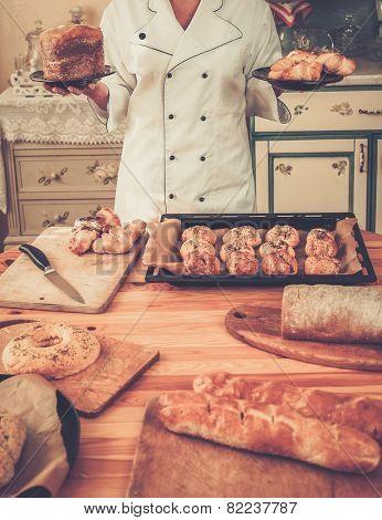 Cook hands holding homemade baked goods