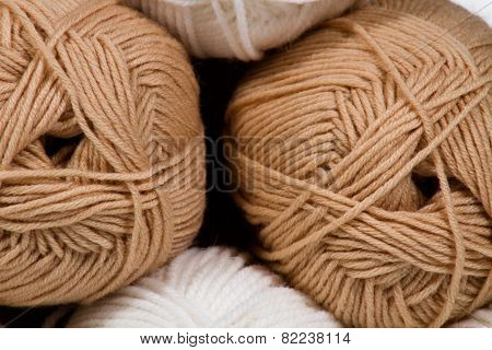 Balls of white and beige wool abstract background