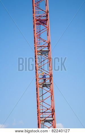 Worker Climbs A Tall Crane