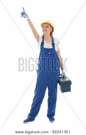 Woman In Blue Builder Uniform With Toolbox Pointing At Something Isolated On White