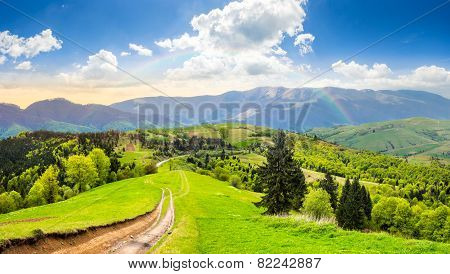Road Through The Meadow On Hillside At Sunrise