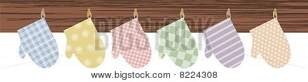 Patterned colorful oven mitts wood board border