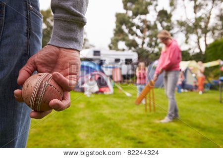 Family Playing Cricket Match On Camping Holiday