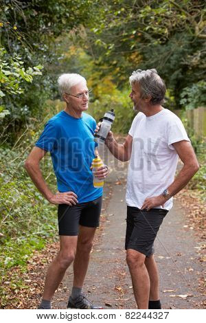 Two Mature Male Joggers Taking Break Whilst On Run