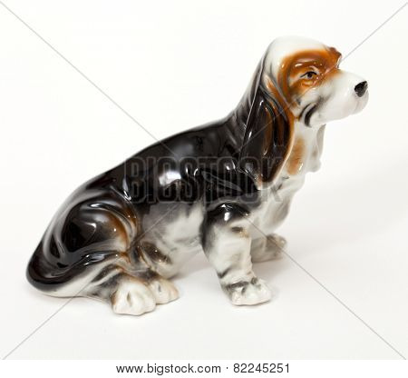 Basset Hound. Ceramic figurine, dog breed isolated on white
