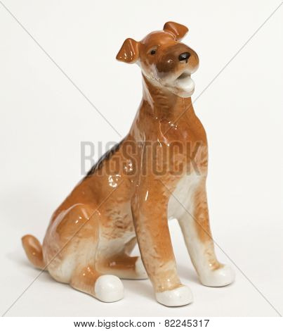 Fox terrier. Ceramic figurine, dog breed isolated on white