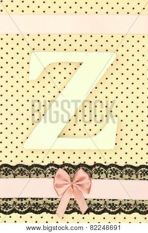 Wooden letter Z on polka dots background