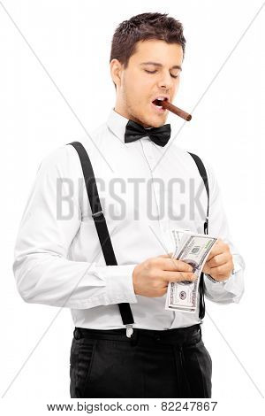 Guy with cigar in his mouth counting money isolated on white background