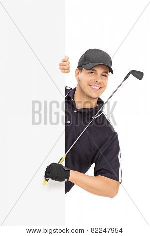 Male golfer posing behind a blank panel isolated on white background