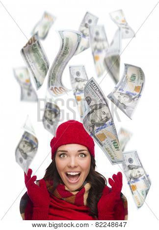 Young Excited Warmly Dressed Woman with $100 Bills Falling Money Around Her on White.