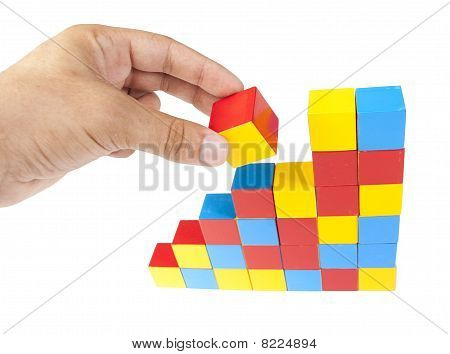 Man's Hand Holding Wooden Block