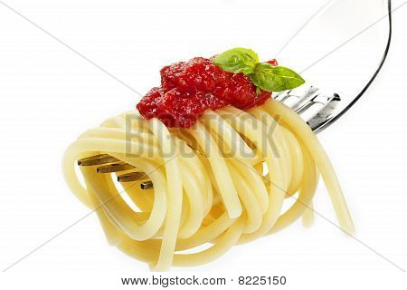 pasta with red sauce and basil on a fork
