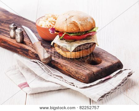 Burger With Coleslaw On White Wooden Background