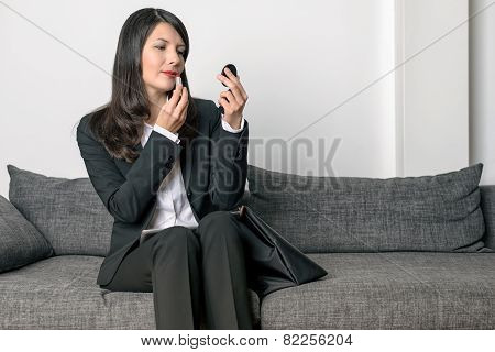 Attractive Woman Refreshing Her Lipstick