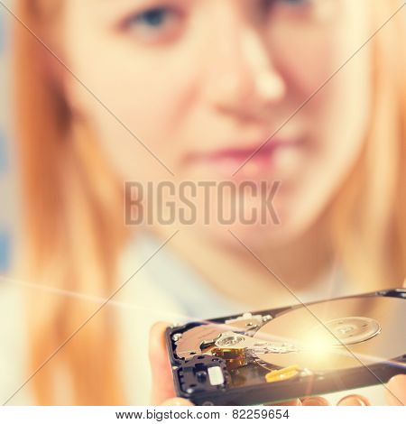 girl student with a hard disk HDD in the hands