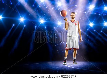 Basketball player is spinning ball around the finger
