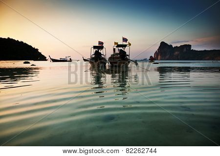 Longtail boats at sunset in Ko Phi Phi, Thailand