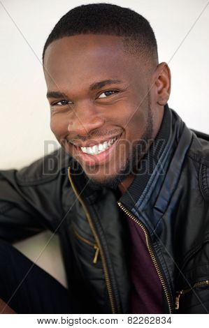 Attractive Young Man Smiling In Black Leather Jacket