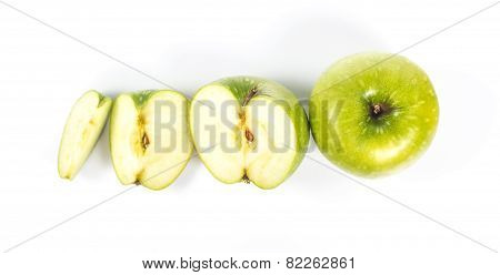 one, half and quarter green apple