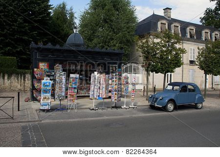 French Streetview With Newspapers Kiosk And Citroen Ugly Duckling
