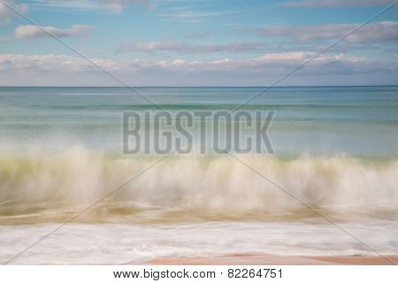 blurry motion of waves splashing on the beach