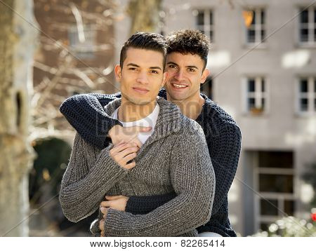 Young Happy Gay Men Couple Cuddling On Street Free Homosexual Love Concept