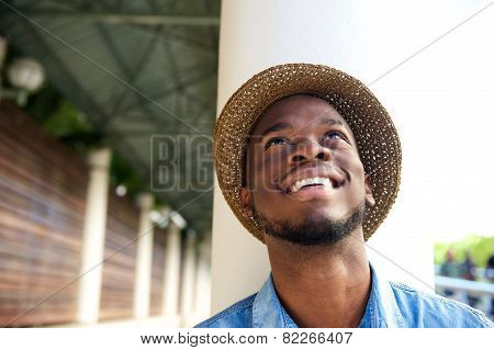 Happy Young Man Smiling And Looking Up