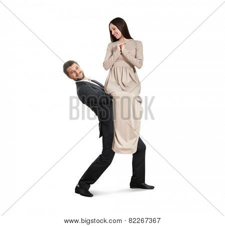 happy couple isolated on white background. smiley man holding on the hands his woman and looking at camera