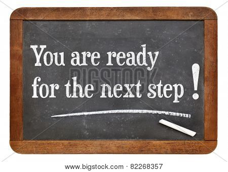 You are ready for the next step - motivational statement  on a vintage slate blackboard