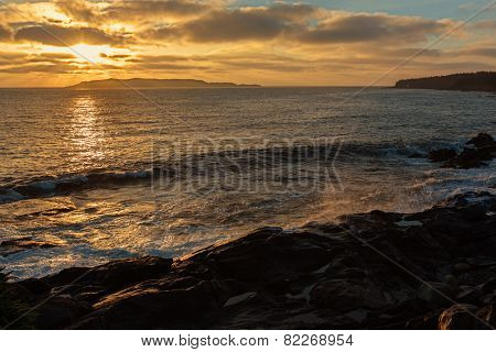 A sunrise along the Newfoundland coast with a view of Witless Bay.