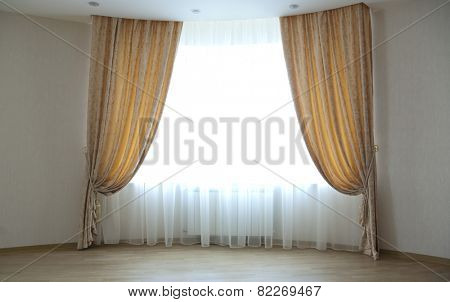 Large window with classical curtains