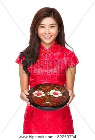 Chinese woman hold with chinese snack tray