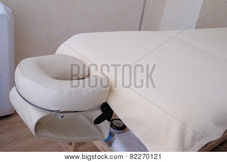 white leather massage table detail