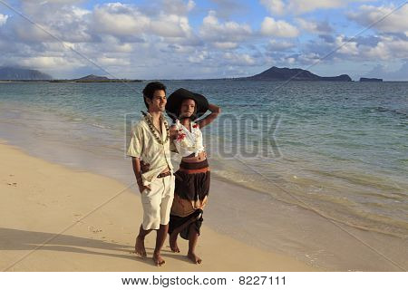 mixed couple walk on the beach