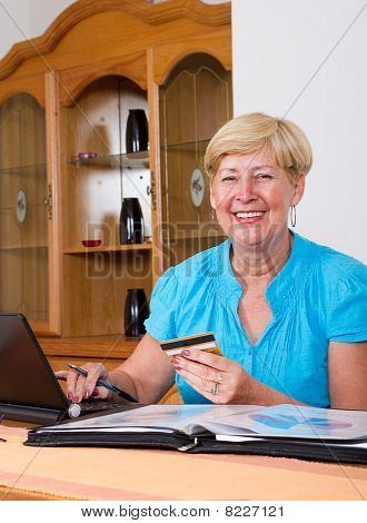 woman buying online with card