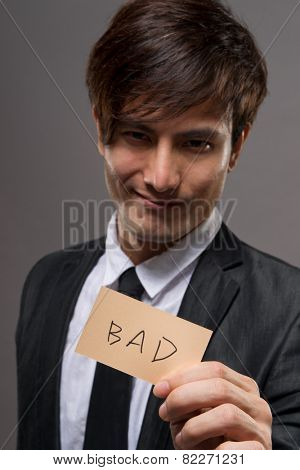 Asian business man holding card writing