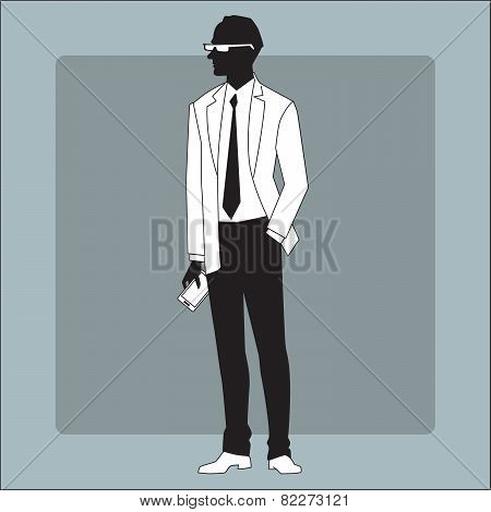 Modern businessman with a gadget in his hand