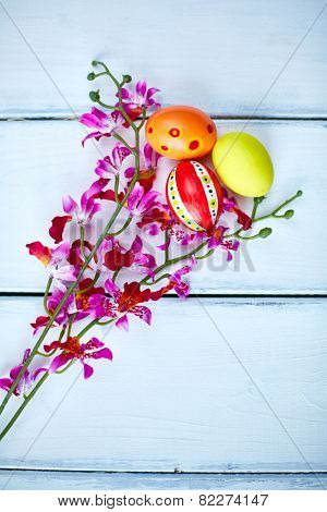 Easter painted eggs with purple orchids