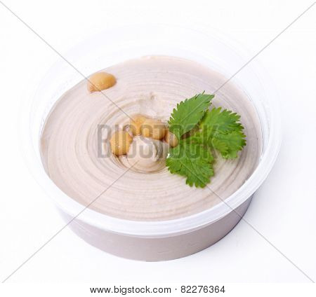 Delicious hummus on a white background