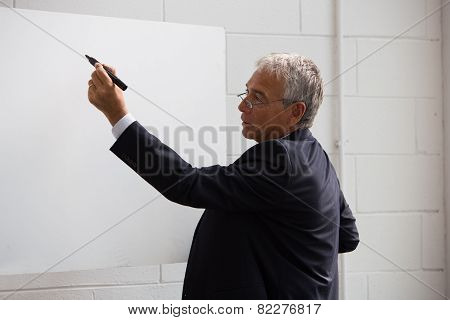 Half length portrait of a businessman wrtiting