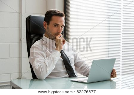 l male businessman looking at camera