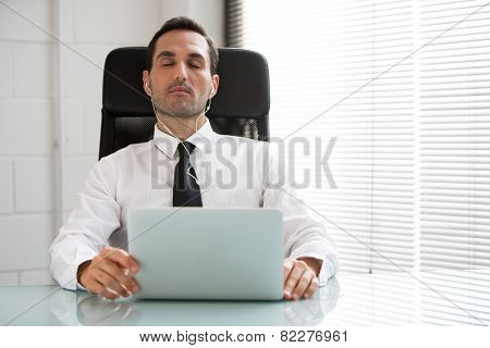 businessman with eyes closed