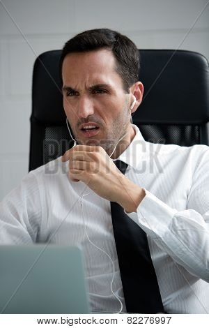 male businessman with earphones